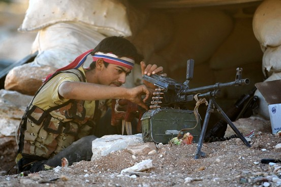 Opposition Fighter Readies his Machine Gun Near Idlib